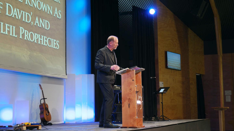 Dr. Andrew Corbett preaching